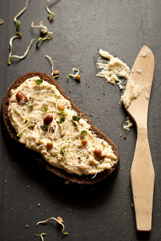 hummus on a slice of pumpernickel bread