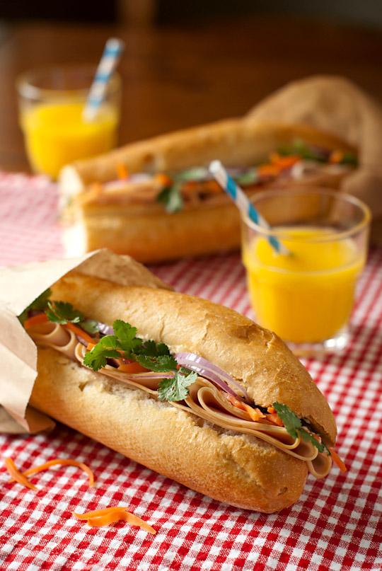 Banh Mi sandwich with orange juice
