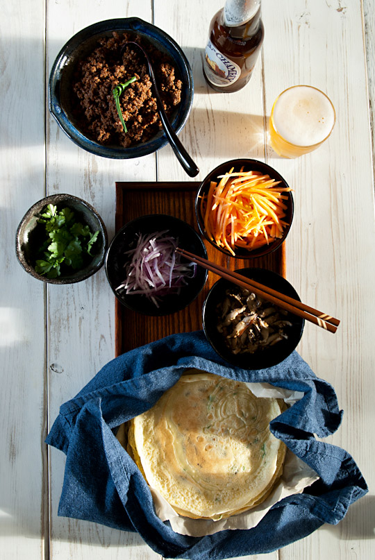 chive crêpes with miso flavoured ground beef, carrots, red onion, cilantro and sauteed mushrooms