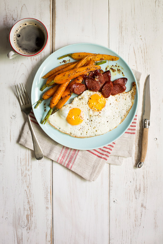 fried eggs with chorizo and glazed carrots