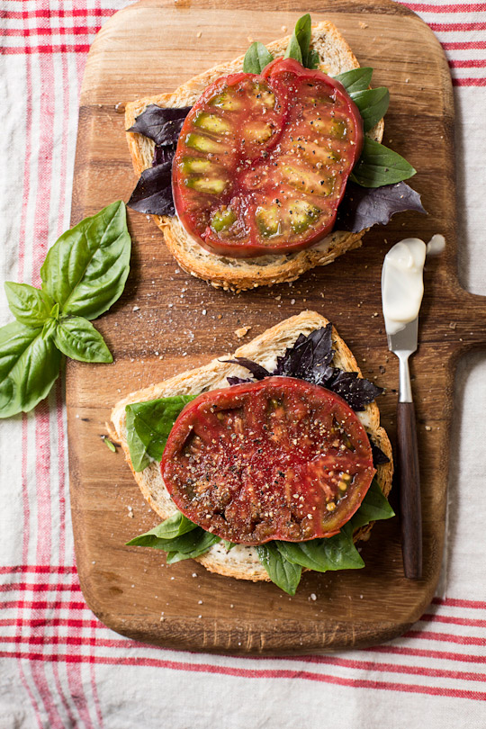 basil and heirloom tomato open faced sandwich